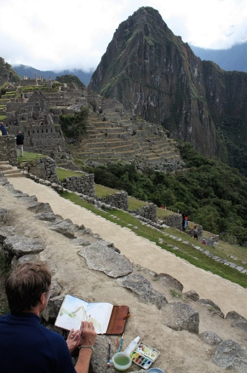 A photo of me painting at Machu Picchu
